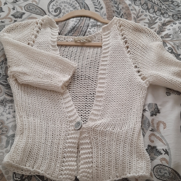 Short white knit sweater